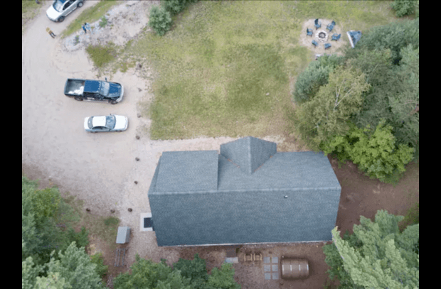 Drone shot of front yard with fire pit