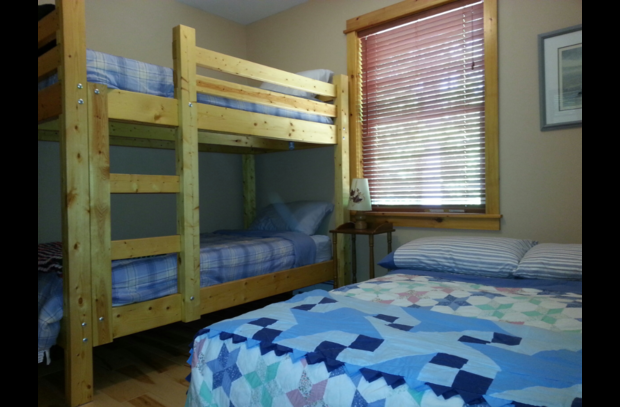 Bunk Bed guest room with open queen