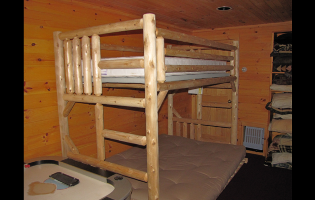 Dorm room has full bunk bed, sleeps 3