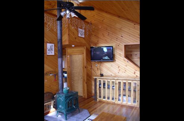 Living area with wood stove and flat screen
